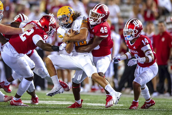 Indiana linebacker Aaron Casey (46) stops Idaho quarterback Zach Borisch (13) near the line of scrimmage during the second half of an NCAA college football game Saturday, Sept. 11, 2021, in Bloomington, Ind. (AP Photo/Doug McSchooler)