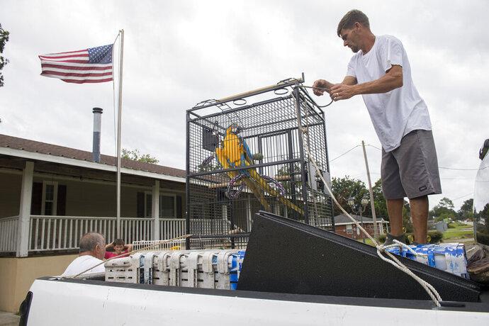 Casey Evans, 33, evacuates a bird named Malibu as residents of eastern St. Bernard Parish, La., evacuate for Hurricane Sally on Monday, Sept. 14, 2020. (Chris Granger/The Advocate via AP)