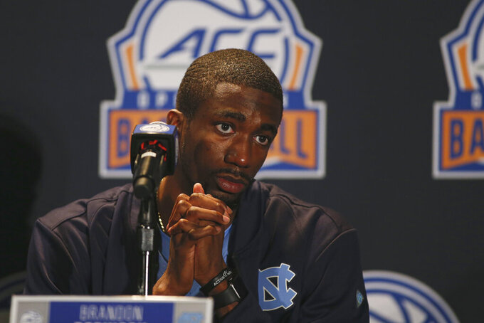 North Carolina player Brandon Robinson considers a question during the Atlantic Coast Conference NCAA college basketball media day in Charlotte, N.C., Tuesday, Oct. 8, 2019. (AP Photo/Nell Redmond)