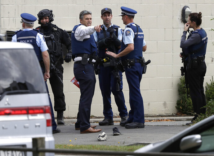 FILE - In this March 15, 2019, file photo, police stand outside a mosque in central Christchurch, New Zealand. New Zealand police on Wednesday, April 17, 2019 released a detailed timeline of their response to the March 15 shootings that left 50 dead at two Christchurch mosques, confirming they arrested the suspected shooter 18 minutes after receiving the first emergency call. (AP Photo/Mark Baker, File)