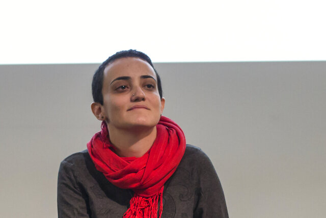 In this Nov. 24, 2017 photo, Lina Attalah, editor-in-chief of Mada Masr, a prominent investigative media outlet in Egypt, participates in a panel discussion at cultural center  in Cairo, Egypt. Mada Masr said editor Lina Attalah was arrested Sunday, May 17, 2020, outside Cairo's Tora prison complex. She was there to interview the mother of a prominent jailed activist. It's the latest arrest amid a wider crackdown on dissent. (AP Photo/Roger Anis)