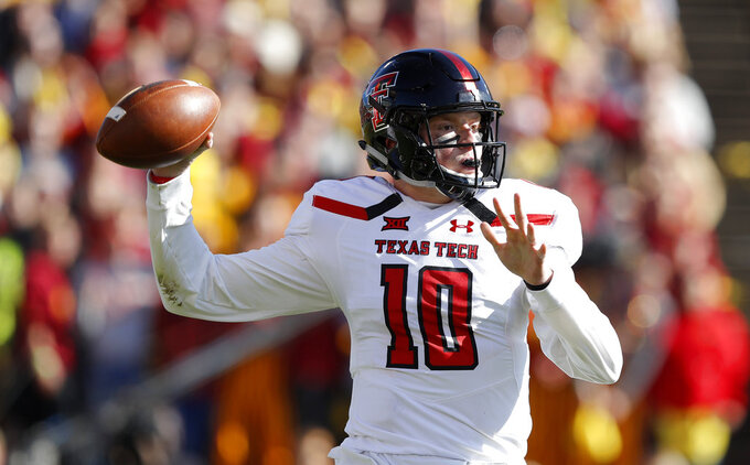 Texas Tech quarterback Alan Bowman throws a pass during the first half of an NCAA college football game against Iowa State, Saturday, Oct. 27, 2018, in Ames, Iowa. (AP Photo/Charlie Neibergall)