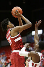 Stanford guard Marcus Sheffield, left, shoots while defended by Washington State guard Viont'e Daniels during the second half of an NCAA college basketball game in Pullman, Wash., Saturday, Jan. 19, 2019. Stanford won 78-66. (AP Photo/Young Kwak)