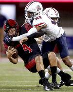 Arizona safety Jaxen Turner (21) stops San Diego State quarterback Jordon Brookshire on a scramble during the first half of an NCAA college football game Saturday, Sept. 11, 2021, in Tucson, Ariz. (Kelly Presnell/Arizona Daily Star via AP)