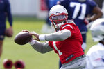 "New England Patriots quarterback Cam Newton (1) winds up for a pass during an NFL football training camp practice, Wednesday, Aug. 26, 2020, in Foxborough, Mass. Newton said. ""And until we find a fix, I think more than ever, we have to unify and become one as much as possible. From the Black Lives Matter campaign, from the social injustice, bringing awareness with that, and just everybody becoming more aware of certain things and not necessarily turning their ear or turning their face (away from) things that are extremely blatant. ""It becomes hard being a father. It becomes hard knowing, yeah, what your day job is. But yet we have to use our platform to raise awareness for issues like this.""(AP Photo/Steven Senne, Pool)"
