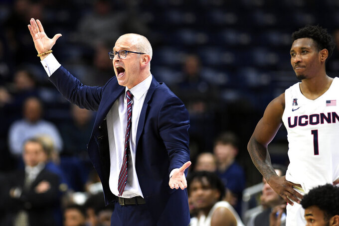 Connecticut coach Dan Hurley questions referees during the second half of the team's NCAA college basketball game against Tulane on Wednesday, Jan. 8, 2020, in Storrs, Conn. (AP Photo/Stephen Dunn)