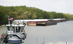 In this Tuesday, May 14, 2019 photo, empty barges are moored on the Mississippi River in St. Paul, Minn., as spring flooding interrupts shipments on the river. Historic Midwest flooding that began in March has left parts of the Mississippi River closed for business. (AP Photo/Jim Mone)