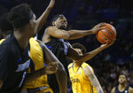 Buffalo guard CJ Massinburg (5) looks to shoot against Kent State during the first half of an NCAA college basketball game, Friday, Feb. 22, 2019, in Buffalo, N.Y. (AP Photo/Jeffrey T. Barnes)