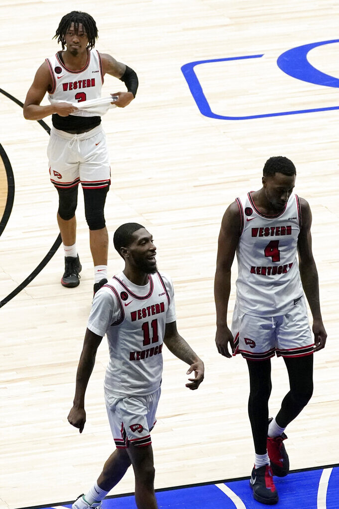 Western Kentucky's Taveion Hollingsworth (11), Josh Anderson (4) and Jordan Rawls (3) walk off the court after the team's 72-65 loss in an NCAA college basketball game against Louisiana Tech in the quarterfinals of the NIT, Thursday, March 25, 2021, in Frisco, Texas. (AP Photo/Tony Gutierrez)