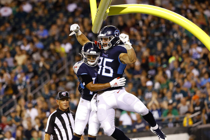 Tennessee Titans' Anthony Firkser, right, and Kalif Raymond celebrate after Firkser's touchdown catch during the first half of the team's preseason NFL football game against the Philadelphia Eagles, Thursday, Aug. 8, 2019, in Philadelphia. (AP Photo/Michael Perez)