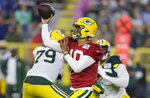 Green Bay Packers quarterback Jordan Love throws a pass during an NFL football training camp at Lambeau Field Saturday, Aug. 7, 2021, in Green Bay, Wis. (AP Photo/Matt Ludtke)