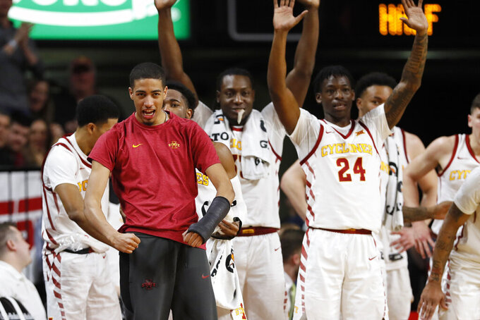 Injured Iowa State guard Tyrese Haliburton, left, celebrates with teammates on the bench during the second half of an NCAA college basketball game against Texas, Saturday, Feb. 15, 2020, in Ames, Iowa. Iowa State won 81-52. (AP Photo/Charlie Neibergall)