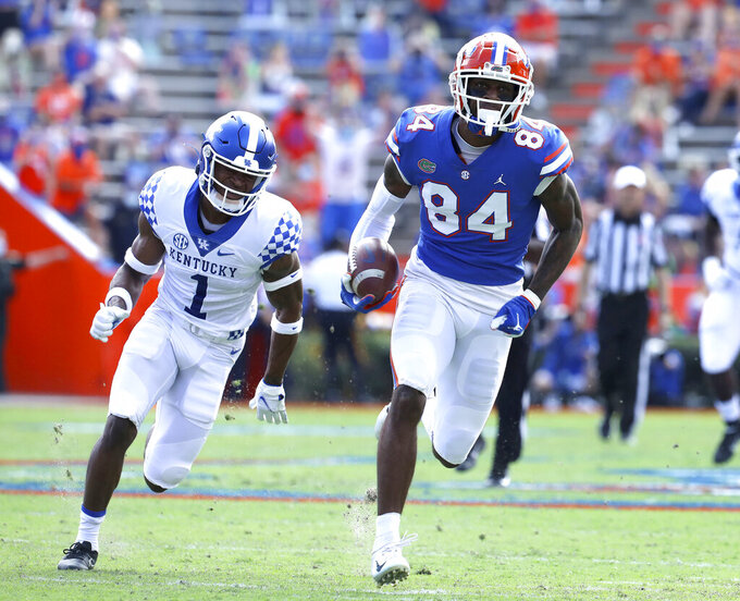 Florida tight end Kyle Pitts (84) runs after catching a pass to score a touchdown during an NCAA college football game against Kentucky in Gainesville, Fla. Nov. 28, 2020. (Brad McClenny/The Gainesville Sun via AP)