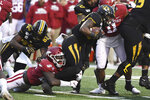 Missouri running back Larry Rountree III is tackled by Arkansas defender Deon Edwards during the second half of an NCAA college football game Friday, Nov. 29, 2019, in Little Rock, Ark. (AP Photo/Michael Woods)