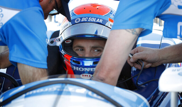 FILE - Ed Jones sits in his car during practice for an IndyCar Series auto race at Iowa Speedway in Newton, Iowa, in this Saturday, July 7, 2018, file photo. Ed Jones will return to IndyCar after a one-year absence for a second stint driving for Dale Coyne Racing. Jones is a British citizen born in the United Arab Emirates who currently lives in Miami. He was sidelined all of 2020 because of COVID-19 travel restrictions. (AP Photo/Charlie Neibergall, File)