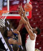 Tulsa forward Simon Falokun (44) blocks the shot by Houston forward Brison Gresham (55) during the first half of an NCAA college basketball game Wednesday, Jan. 2, 2019, in Houston. (AP Photo/Michael Wyke)