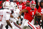 Georgia quarterback Justin Fields (1) looks back during a run against Massachusetts during the first half of an NCAA college football game Saturday, Nov. 17, 2018, in Athens, Ga. (Joshua L. Jones /Athens Banner-Herald via AP)