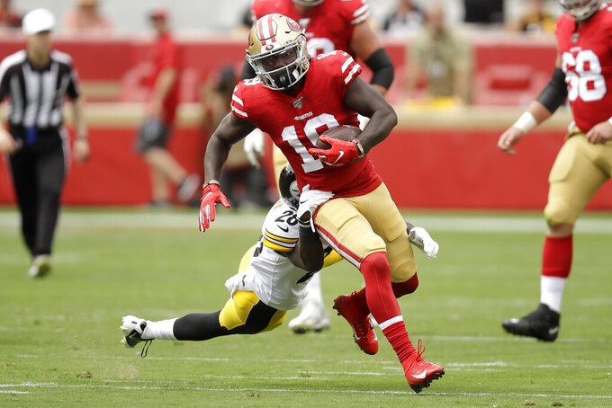 San Francisco 49ers wide receiver Deebo Samuel (19) runs in front of Pittsburgh Steelers cornerback Mike Hilton during the first half of an NFL football game in Santa Clara, Calif., Sunday, Sept. 22, 2019. (AP Photo/Ben Margot)