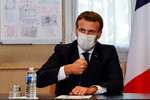 French President Emmanuel Macron chairs a meeting with the medical staff of the Rene Dubos hospital center, in Pontoise, outside Paris, Friday Oct. 23, 2020. French Prime Minister Jean Castex said Thursday a vast extension of the nightly curfew that is intended to curb the spiraling spread of the coronavirus, saying