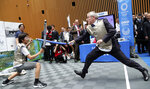 IOC President Thomas Bach, right, performs mock fencing with Japanese junior high school student Yui Hashimoto during a Olympic Games Tokyo 2020 One year to Go ceremony event in Tokyo, Wednesday, July 24, 2019. Bach is a former Olympic fencer and won a team gold medal at the 1976 Montreal Games. Fans, sponsors and politicians celebrated the day around the Japanese capital, displaying placards and clocks showing 365 days to go until the opening ceremony on July 24, 2020. (AP Photo/Koji Sasahara, Pool)