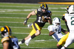 FILE - In this Saturday, Nov. 7, 2020, file photo, Iowa's Charlie Jones returns a punt during the second half of an NCAA college football game against Michigan State, in Iowa City, Iowa. Jones' play has been a key factor in Iowa's special teams success. (AP Photo/Charlie Neibergall, File)