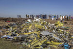 FILE - In this March 11, 2019, file photo, wreckage is piled at the crash scene of an Ethiopian Airlines flight crash outside Addis Ababa, Ethiopia. Ethiopian Airlines' former chief engineer Yonas Yeshanew, who is seeking asylum in the U.S., says in a whistleblower complaint filed with regulators that the carrier went into maintenance records on a Boeing 737 Max jet after it crashed this year, a breach he contends was part of a pattern of corruption that included routinely signing off on shoddy repairs. (AP Photo/Mulugeta Ayene, File)