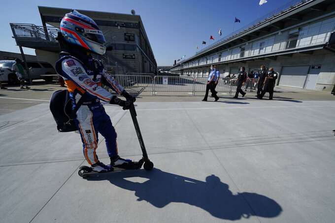 Takuma Sato, of Japan, makes his way to pit lane before qualifications for the Indianapolis 500 auto race at Indianapolis Motor Speedway, Saturday, Aug. 15, 2020, in Indianapolis. (AP Photo/Darron Cummings)