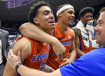 Florida's Andrew Nembhard, Isaiah Stokes and Kevarrius Hayesin, from left, celebrate the team's 82-77 overtime win over LSU in an NCAA college basketball game Wednesday, Feb. 20, 2019, in Baton Rouge, La. (AP Photo/Bill Feig)