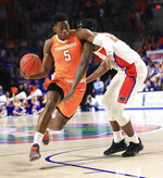 Tennessee guard Admiral Schofield (5) drives past Florida forward Dontay Bassett (21) during the first half of an NCAA college basketball game Saturday, Jan. 12, 2019, in Gainesville, Fla. (AP Photo/Matt Stamey)