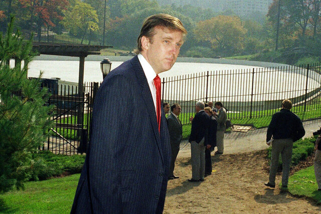 FILE - In this Oct. 23, 1986, file photo, Donald Trump is photographed in New York's Central Park, in front of the Wollman Skating Rink, which he offered to rebuild after the city's renovation effort had come to a standstill. New York City is looking to terminate its contracts with President Donald Trump to run two Central Park skating rinks and other facilities after a Trump-inspired mob rioted and breached the U.S. Capitol last week, Mayor Bill de Blasio said Tuesday, Jan. 12, 2021. (AP Photo/Mario Suriani, File)