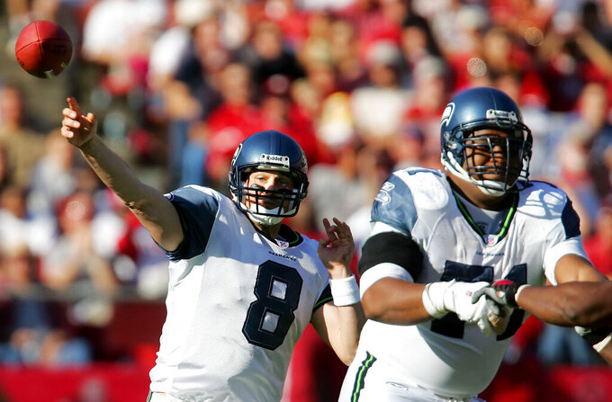 FILE - In this Nov. 20, 2005, file photo, Seattle Seahawks quarterback Matt Hasselbeck (8) throws downfield while protected by lineman Walter Jones (71) during the first half of an NFL football game against the San Francisco 49ers in San Francisco. Three former first-round picks by Seattle are already in the Pro Football Hall of Fame, with a fourth set to be inducted later this year. With respect to safety Kenny Easley (No. 4 in 1981), the late Cortez Kennedy (No. 3 in 1990) and Steve Hutchinson (No. 17 in 2001), the nod goes to left tackle Jones. While Easley, Kennedy and Hutchinson were dominant players at their positions, Jones is in the conversation as the best left tackle of all-time. Jones was the second of Seattle's two first-round picks in 1997, selected at No. 6 overall. (AP Photo/Jeff Chiu, File)