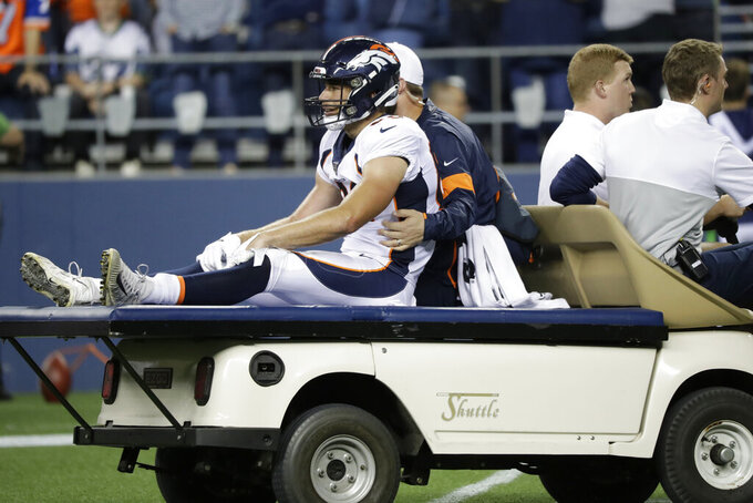 Denver Broncos tight end Austin Fort is carted off the field with an injury after a reception during the second half of the team's NFL football preseason game against the Seattle Seahawks, Thursday, Aug. 8, 2019, in Seattle. (AP Photo/Elaine Thompson)