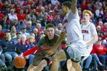 Utah guard Rylan Jones (15) drives against Arizona guard Nico Mannion and Ira Lee (11) during the first half of an NCAA college basketball game Thursday, Jan. 16, 2020, in Tucson, Ariz. (AP Photo/Rick Scuteri)