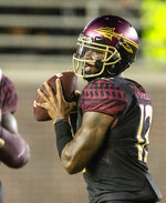 FILE - In this Sept. 3, 2018, file photo, Florida State quarterback Deondre Francois (12) passes against Virginia Tech during an NCAA college football game in Tallahassee, Fla. Francois and Miami's N'Kosi Perry will certainly be the centers of attention Saturday when the Seminoles (3-2, 1-2 Atlantic Coast Conference) visit the 17th-ranked Hurricanes (4-1, 1-0). (AP Photo/Mark Wallheiser, File)