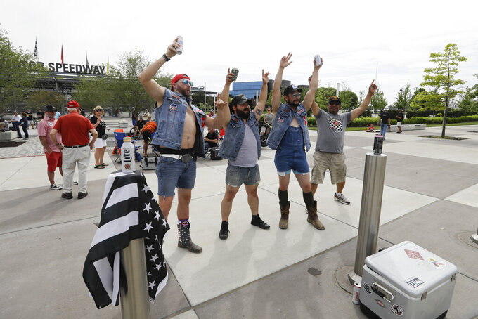 Fans gather outside of the main gate at Indianapolis Motor Speedway, Sunday, May 24, 2020, in Indianapolis. (AP Photo/Darron Cummings)
