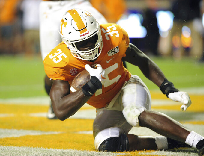 Tennessee linebacker Daniel Bituli gets to his feet after recovering a blocked punt against South Carolina during an NCAA college football game in Knoxville, tenn., Saturday, Oct. 26, 2019.  (Scott Keller/The Daily Times via AP)