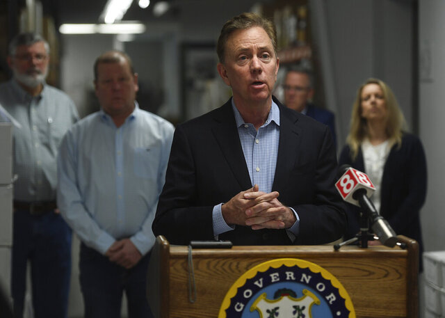 FILE - In this March 29, 2020, file photo, Connecticut Gov. Ned Lamont addresses the media at medical equipment manufacturer Bio-Med Devices in Guilford, Conn. On Thursday, July 2, 2020, Lamont announced a change to the required 14-day quarantine for visitors from states with high COVID-19 infection rates. He believes the quarantine announced the week before by Connecticut, New Jersey and New York has limited the number of Connecticut's out-of-state visitors. (Brian A. Pounds/Hearst Connecticut Media via AP, File)