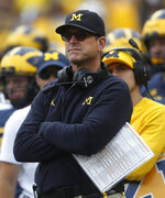 FILE - In this Sept. 22, 2018, file photo, Michigan head coach Jim Harbaugh watches in the second half of an NCAA football game against Nebraska in Ann Arbor, Mich. Following a Big Ten victory and a bye, Maryland faces its toughest test yet _ a matchup against No. 15 Michigan at the Big House. (AP Photo/Paul Sancya, File)