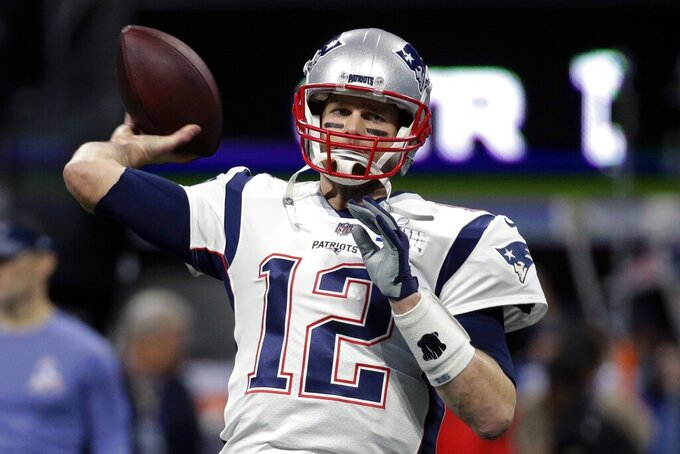 New England Patriots' Tom Brady warms up before the NFL Super Bowl 53 football game between the Patriots and the Los Angeles Rams, Sunday, Feb. 3, 2019, in Atlanta. (AP Photo/Patrick Semansky)