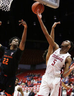 Oregon State forward Warren Washington (22) and Washington State forward Marvin Cannon (5) go after a rebound during the first half of an NCAA college basketball game in Pullman, Wash., Saturday, March 9, 2019. (AP Photo/Young Kwak)