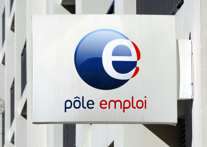 FILE - In this Feb.24, 2015 file photo, a Job Center (Pole Emploi) logo is pictured in Marseille, southern France. The overhaul of the unemployment insurance is the latest of French President Emmanuel Macron's changes to make the country's labor market more flexible. New rules making it more difficult for the unemployed to claim benefits are entering into force on Friday.(AP Photo/Claude Paris, File)