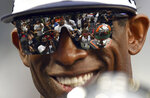 Jackson State head football coach Deion Sanders smiles as he holds the Orange Blossom Classic trophy after winning an NCAA college football game over Florida A&M, Sunday, Sept. 5, 2021, in Miami Gardens, Fla. (AP Photo/Jim Rassol)