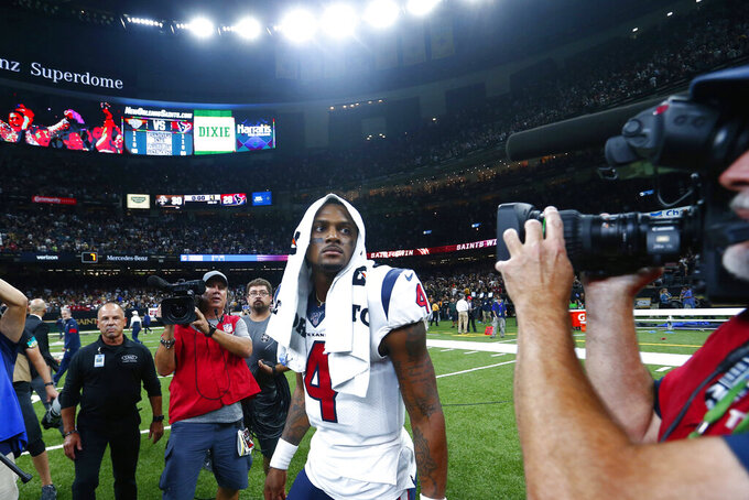 Houston Texans quarterback Deshaun Watson (4) walks off the field after an NFL football game against the New Orleans Saints in New Orleans, Monday, Sept. 9, 2019. The Saints won 30-28. (AP Photo/Butch Dill)