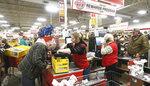 Tractor Supply Company clerk Alex Ehasz, center,  helps customer Scott Campbell at the Ashtabula Township, Ohio, store around 6 a.m. on Friday Nov.  29, 2019.  The 2019 holiday season will be a good measure of the U.S. economy's health.   (Warren Dillaway /The Star-Beacon via AP)