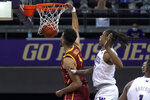 Southern California forward Isaiah Mobley dunks next to Washington forward Hameir Wright during the first half of an NCAA college basketball game Thursday, Feb. 11, 2021, in Seattle. (AP Photo/Ted S. Warren)