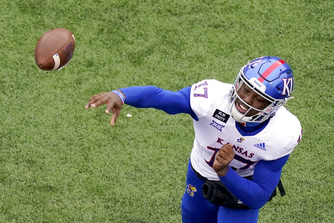 Kansas quarterback Jalon Daniels throws the ball during the second half of an NCAA football game against Kansas State Saturday, Oct. 24, 2020, in Manhattan, Kan. (AP Photo/Charlie Riedel)