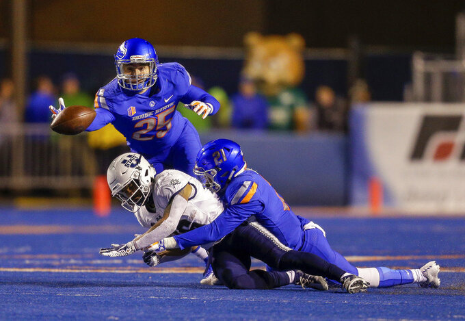 Boise State linebacker Benton Wickersham (25) dives for the ball after Boise State safety Tyreque Jones (21) broke up a pass to Utah State wide receiver Jordan Nathan (16) during the first half of an NCAA college football game, Saturday, Nov. 24, 2018, in Boise, Idaho. (AP Photo/Steve Conner)