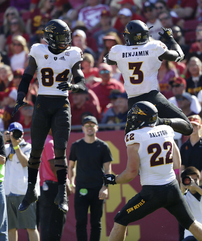 Arizona State running back Eno Benjamin (3) celebrates his rushing touchdown with teammate Frank Darby (84) during the first half of an NCAA college football game Saturday, Oct. 27, 2018, in Los Angeles. (AP Photo/Marcio Jose Sanchez)