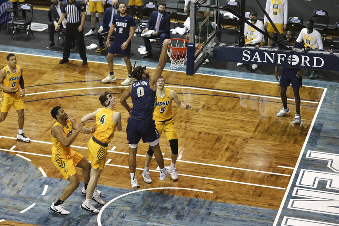 Oral Roberts forward Kevin Obanor (0) dunks against North Dakota State during the first half of an NCAA college basketball game for the Summit League men's tournament championship Tuesday, March 9, 2021, in Sioux Falls, S.D. (AP Photo/Josh Jurgens)