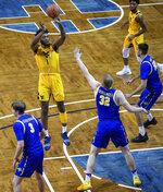 West Virginia guard Kedrian Johnson (1) shoots over South Dakota State forward Matt Dentlinger (32) during an NCAA college basketball game Wednesday, Nov. 25, 2020, in Sioux Falls, S.D. (AP Photo/Josh Jurgens)